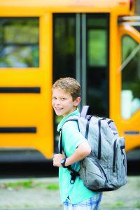 Teenage boy ready to go to school after a good night sleep