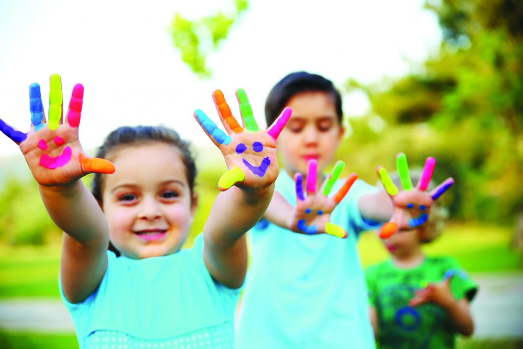 child showing painted hands 1024x683 children s support solutions