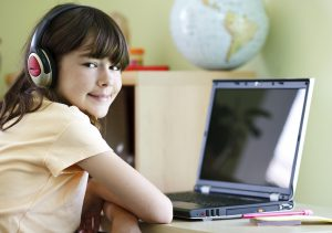 Child using a computer safely and not suffering from cyber dependence or cyber addition