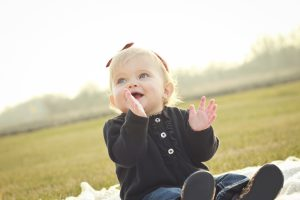 A baby clapping at a Milestones and Me group