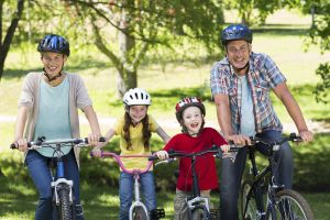 Children learning to ride a bike after his parents got tips from a physiotherapist.