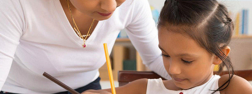 Mother helping her daughter do homework after a Parenting with confidence group