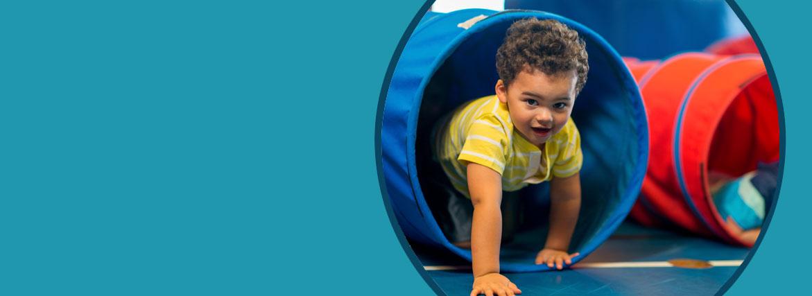 boy crawling through tunnel