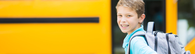Teenage boy leaving school to go to tutoring session.